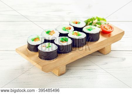 Roll Vegan With Chuka Seaweed On Wooden Plate.