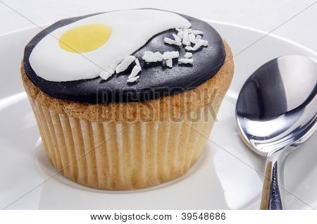 Cupcake With Fried Egg And Grated Coconut