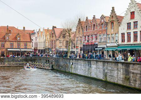 BRUGES, BELGIUM - April 13, 2018: Restaurants in Old Town Bruges, Belgium