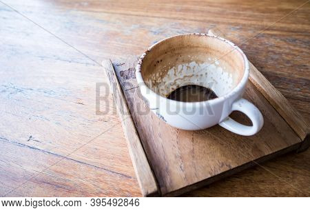 Finished Empty Cup Of Coffee On A Wooden Tray At Coffee Shop.close Up View