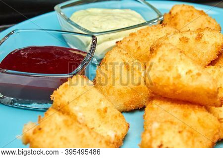 Tempura Nuggets. Fried Chicken Fillet In Breadcrumbs With Berry Sauce And Tartar Sauce