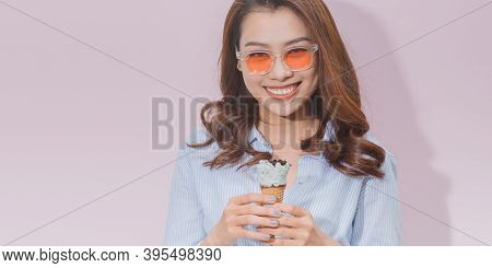 Pretty Asian Girl Or Young Asian Woman Eating Junk Food (woman Eat Ice Cream)