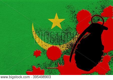 Mauritania Flag And Mk2 Frag Grenade In Red Blood. Concept For Terror Attack Or Military Operations