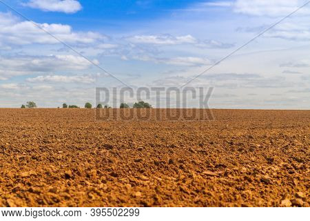 Fresh Plowed Field In Russia. Arable Land In Spring Or Autumn. The Vast, Endless Field With The Soil
