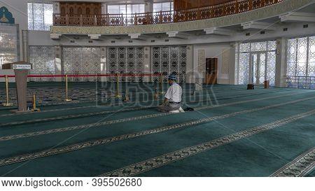 Pavlodar, Kazakhstan - July 27, 2020: Lonely Islamic Prayer In The Mashkhur Jusup Mosque In Pavlodar