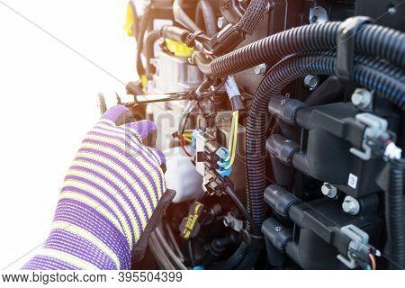 Repairing  Outboard Marine Engine. Motorboat Engine Seasonal Service And Maintenance. Mechanic Yfnd