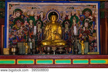 Cheongyang-gun, South Korea; October 2, 2020: Front View Of Seated Gilt-bronze Bhaisajyaguru Buddha
