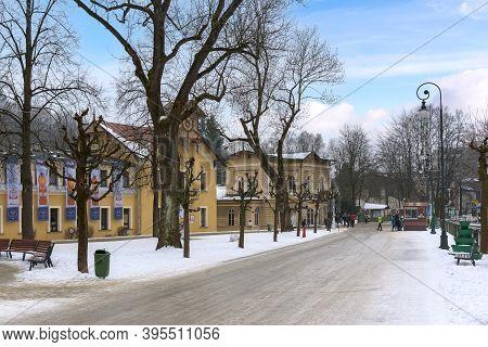 Krynica Zdroj, Poland - January 26, 2020: Tourists Walk Dietls Boulevards, Famous Promenade Of Kryni