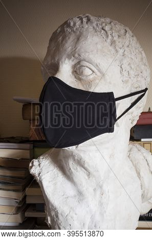 Incomplete Male Bust Wearing Black Face Mask With Book Background. Arts At Pandemic Times Concept
