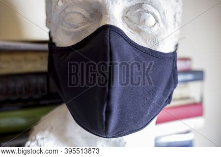 Incomplete Male Bust Wearing Black Face Mask With Book-s Background. Arts At Pandemic Times Concept