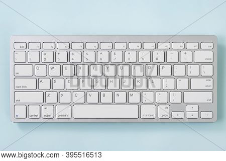 Close Up White Portable Computer Keyboard Keys Or Keyboard Button On Blue Pastel Minimalist Backgrou