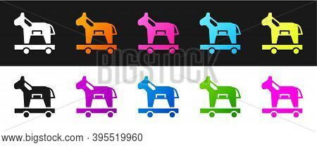 Set Trojan Horse Icon Isolated On Black And White Background. Vector