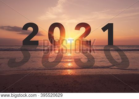 New Year 2021 Is Coming With Sunset Beach Background. New Start For Planing Or Set New Resolution In