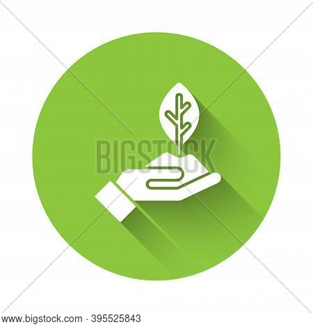 White Plant In Hand Of Environmental Protection Icon Isolated With Long Shadow. Seed And Seedling. P