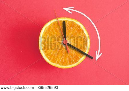 Orange With Clock Hands, Eight Hour Intermittent Fasting Diet Concept