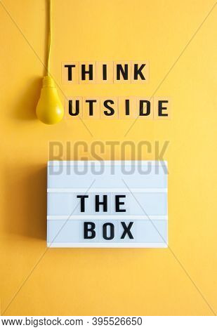 Think Outside The Box Message Box With Light Bulb