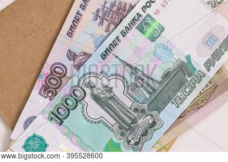 Russian Money Is On The Envelope. Paper Bills Of Five Hundred And One Thousand Rubles. A Stack Of Ba