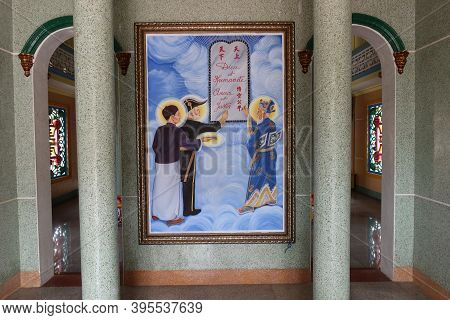 Hoi An, Vietnam, November 19, 2020: Mural On The Entrance Door Of The Cao Dai Temple In Hoi An
