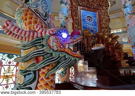 Hoi An, Vietnam, November 19, 2020: Dragon Next To The All-seeing Eye In The Main Hall Of Worship Of