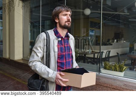 An Unemployed Manager With A Box Of Documents Lost His Job Due To The Global Economic Crisis. Unempl