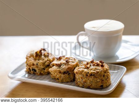 Traditional British Cheese Scones With Blurry Cup Of Coffee And  Book Background, Freshly Baked Scon