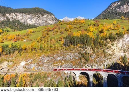 Filisur, Switzerland - October 26, 2019: A Red Train Is Crossing The Famous Landwasser Viaduct - A U
