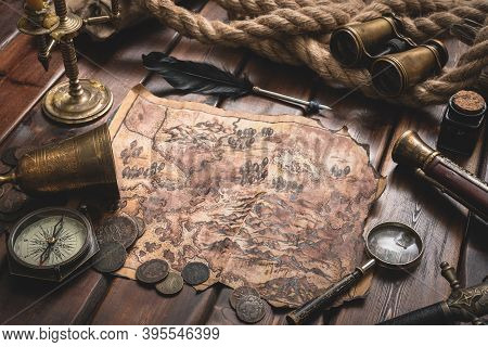 Pirate Treasure Map On The Old Wooden Table Concept Background.