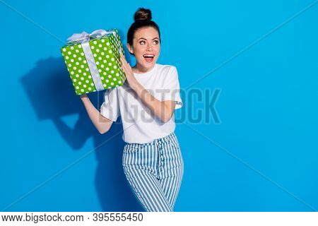 Portrait Of Positive Crazy Interested Girl Hold Big Green Gift Box Shake Want Know What Get 14-febru