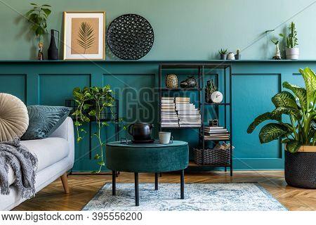 Nterior Design Of Living Room With Gray Sofa, Design Pouf, Coffee Table, Shlef, Basket, Carpet And E