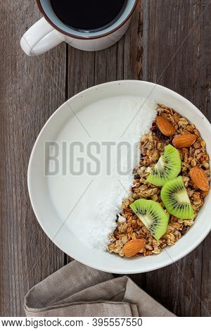 Muesli With White Yogurt, Kiwi And Coconut. Healthy Eating. Vegetarian Food. Breakfast