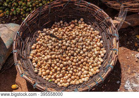 Kadenahalli, Karnataka, India - November 3, 2013: Closeup Of Basket Half Full With Just Coming Out O