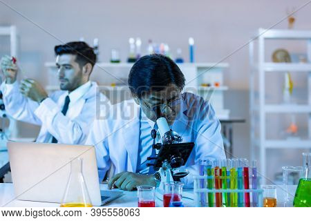 Microbiologist Biotechnology Researcher Look Microscope In The Lab