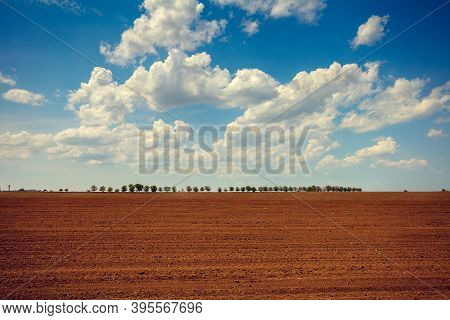 Cloudy Blue Sky Over An Arable Field