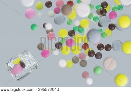 Multicolored Medical Pills Fly Out Of Glass Jar
