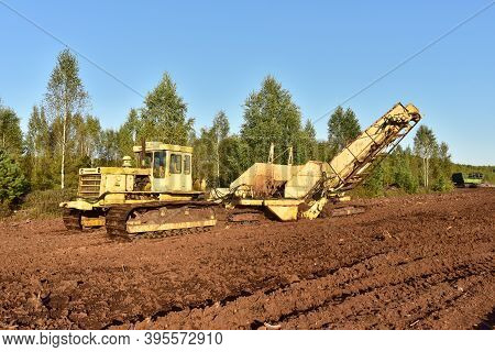 Root Harvester For Clear Surface Vegetation And Cut Through Trees And Stumps In The Bog. Machinery F