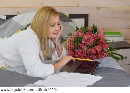 Cute Blonde Woman With Beautiful Bouquet Of Fresh Flowers. Bouquet For The Girl. Women's Internation