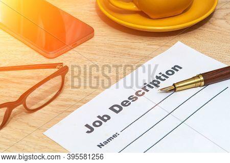 Job Description Form On Office Desk With Elegant Pen And Smartphone. Business Idea