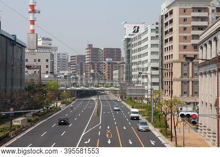Kobe, Japan - April 24, 2012: Street Traffic View Of Kobe, Japan. Kobe Is The 6th Largest City Of Ja