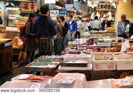 Tokyo, Japan - May 11, 2012: Merchants Sell Seafood At Tsukiji Fish Market In Tokyo. It Is The Bigge