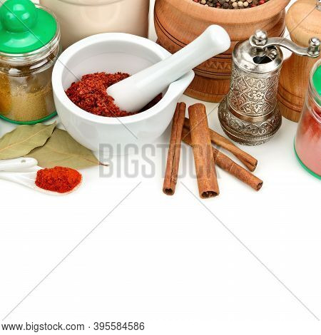 Set Of Aromatic Spices And Seasonings Isolated On A White Background. Free Space For Text.