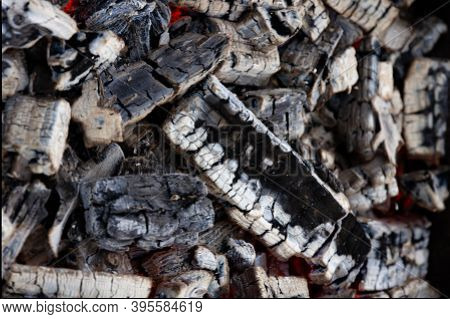 embers close-up in a charcoal grill for barbecue and grilling outdoors