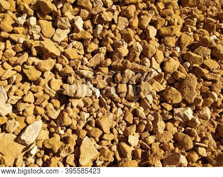 Yellow Gravel Close-up. View From Above. A Place For Text. Texture. Background. Gravel Takes The Who