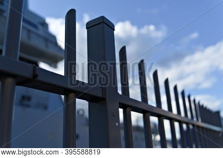 Steel Security Fence Protecting A Perimeter At The Port From Entry.