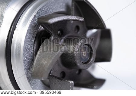 Close-up Car Engine Cooling Water Pump On Gray Background