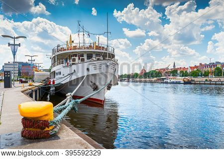 Large Boat Docked Or Moored On Customs Quay, View On Promenade And Boulevards On Odra River Embarkme