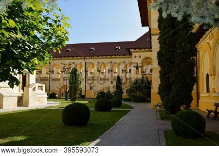 Alba Iulia, Romania - September 20, 2020: The Inner Court Of The Coronation Cathedral. The Buildings
