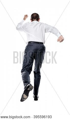 businessman running from behind isolated on white.
