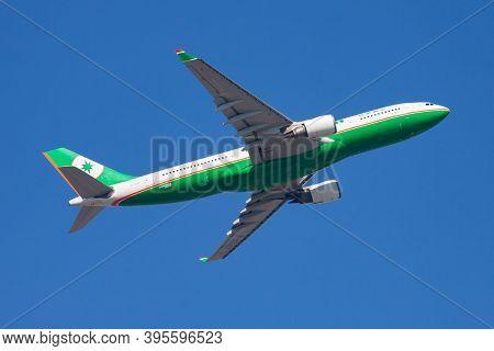 Hong Kong / China - December 1, 2013: Eva Air Airbus A330-200 B-16307 Passenger Plane Departure And