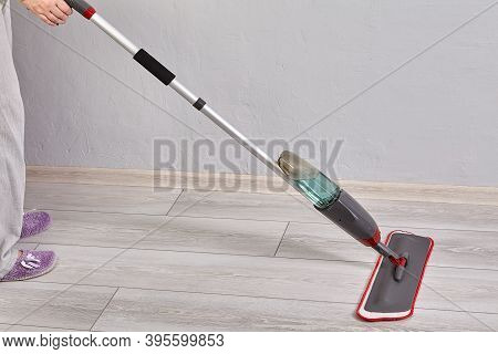 Flat Spray Mop With Microfiber Pad And Trigger Sprayer For Water Spraying With Mount Of Handle End.