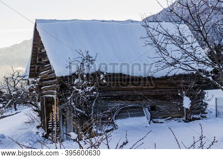 Snow-covered Chalet In The Swiss Alps